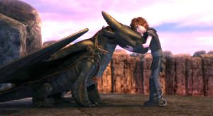 Hiccup hugging Toothless