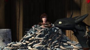 Hiccup almost completely buried in fish, and Toothless looking at him smugly.