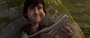 Hiccup eating regurgitated fish, scene from HTTYD 1.