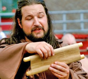 Man reading from scroll